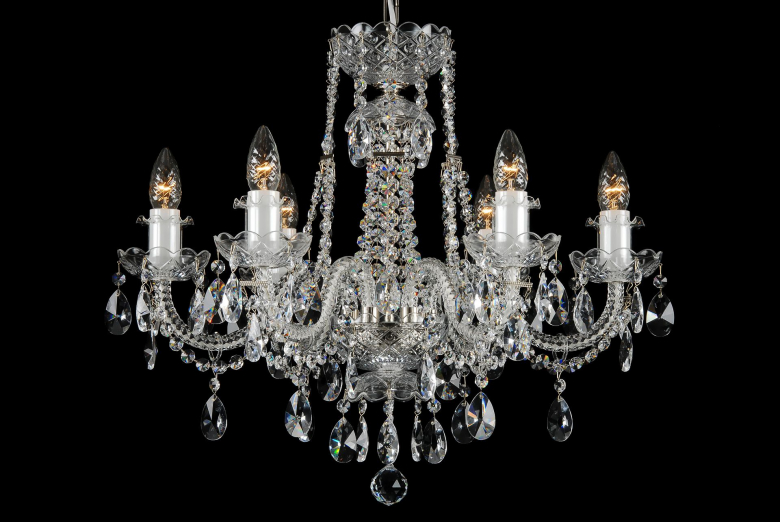 A six-arm chandelier with silver coloured metal decorated by crystal chains.