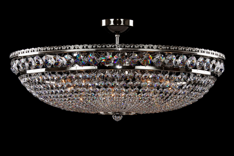 A sparkling silver crystal chandelier shaped like a basket.