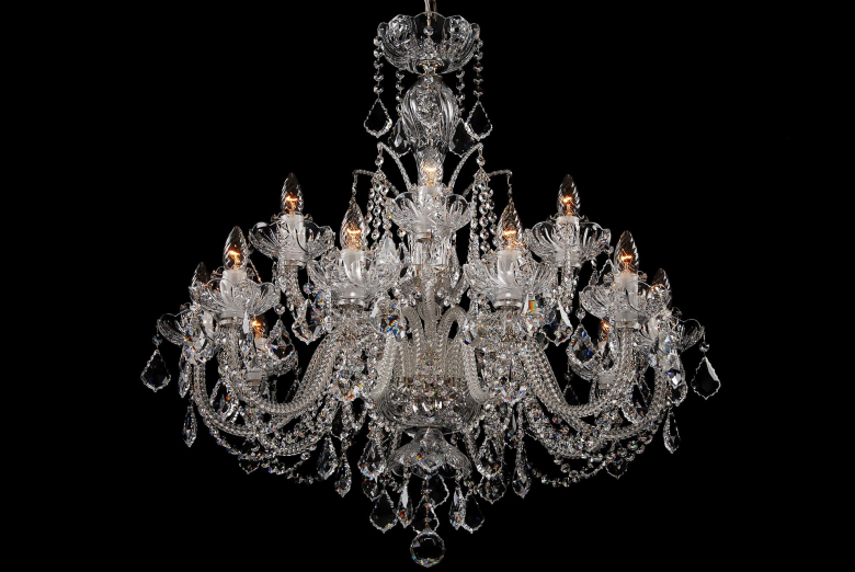 A fifteen-arm crystal chandelier ornamented with Swarovski trimmings.