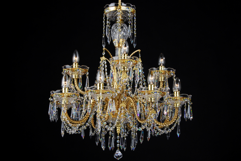 A golden crystal chandelier with 12 arms.