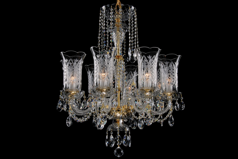 An eight-arm crystal chandelier decorated with hand cut vases.