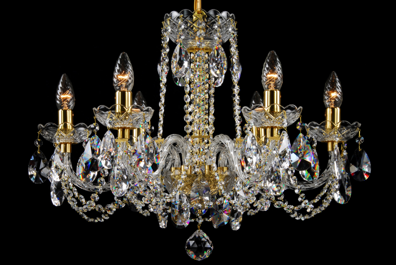 A six-arm gold crystal chandelier is suitable for interiors with low ceiling.