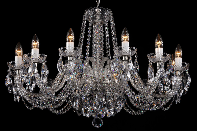 A crystal chandelier with silver coloured metal suitable for low ceilings.