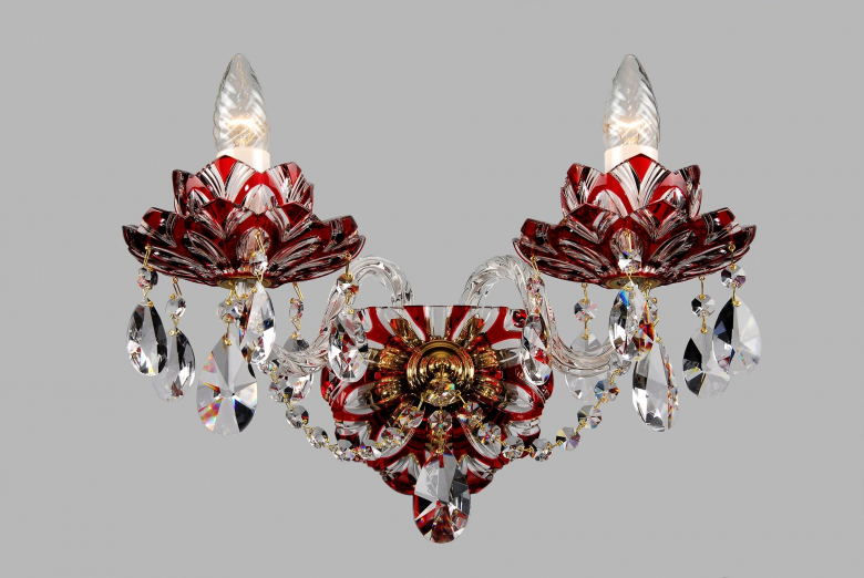 A two-arm red crystal wall lamp with lotus flower design.