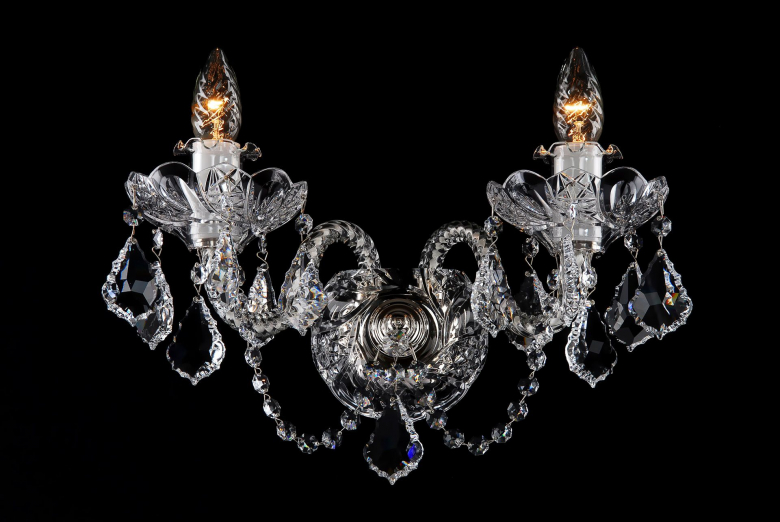 A two-arm crystal wall lamp ornamented with Swarovski trimmings.