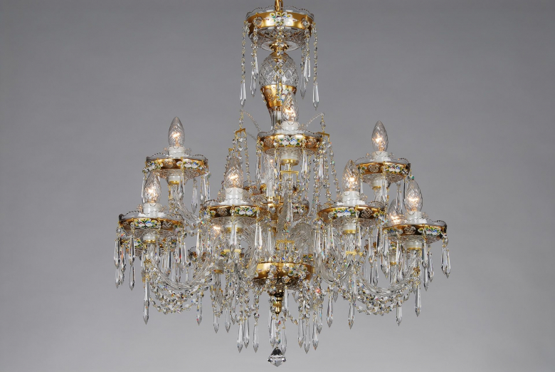 A golden crystal chandelier ornamented with hand painted motifs.