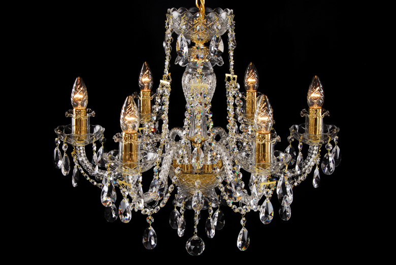 A six-arm crystal chandelier with golden metal