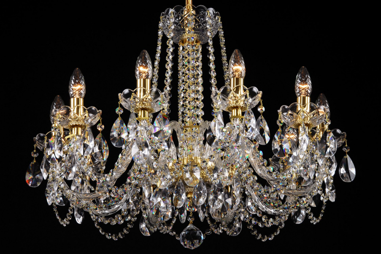 A crystal chandelier with gold coloured metal suitable for interiors with low ceiling.