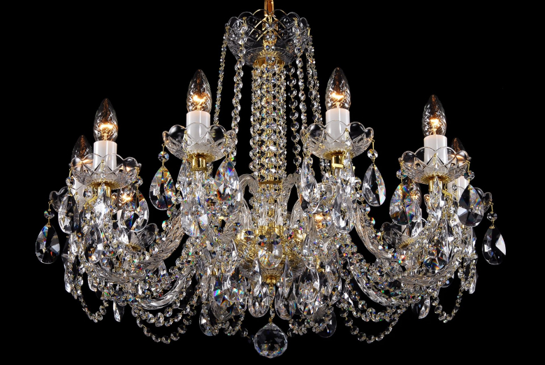 A ten-arm clear crystal chandelier is suitable for interiors with low ceilings.