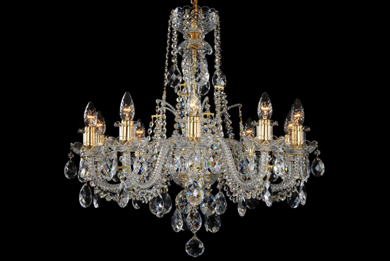 A ten-arm crystal chandelier with gold coloured metal.