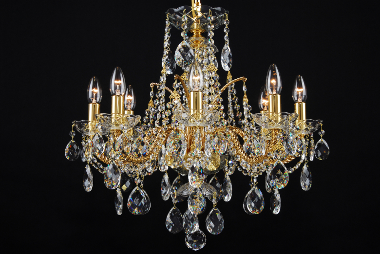 Gold coated chandelier with 8 arms.