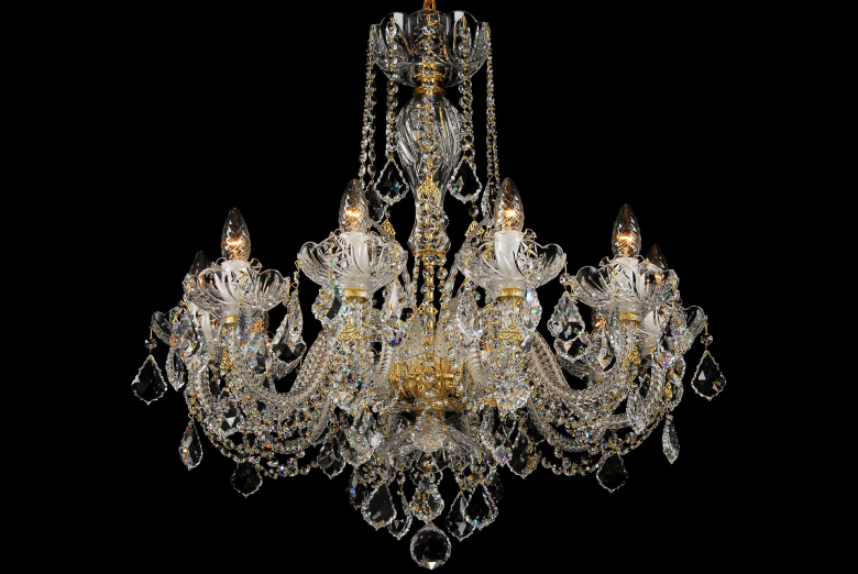 A clear hand cut crystal chandelier decorated with Swarovski trimmings.
