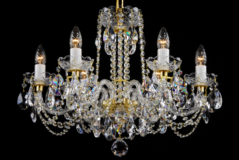 A six-arm clear crystal chandelier is suitable for interiors with low ceiling.