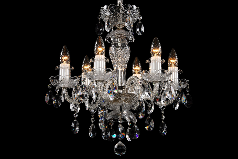 A small six-arm crystal chandelier with silver coloured metal.