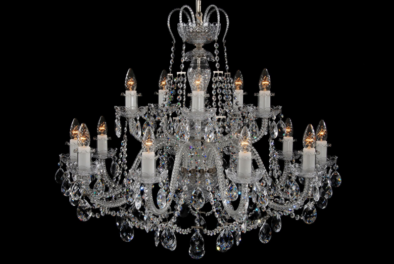 A fifteen-arm crystal chandelier with a crown and silver coloured fittings.