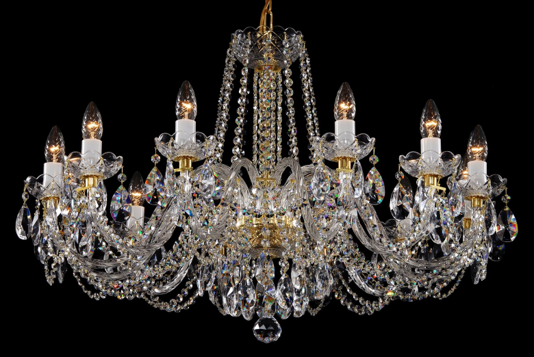 A neutral crystal chandelier is suitable for interiors with low ceilings.
