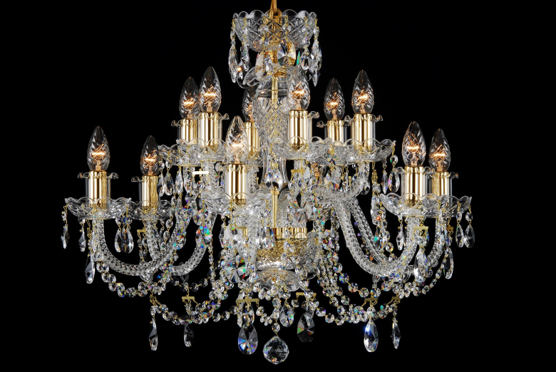 A twelve-light crystal chandelier decorated with crystal chains.