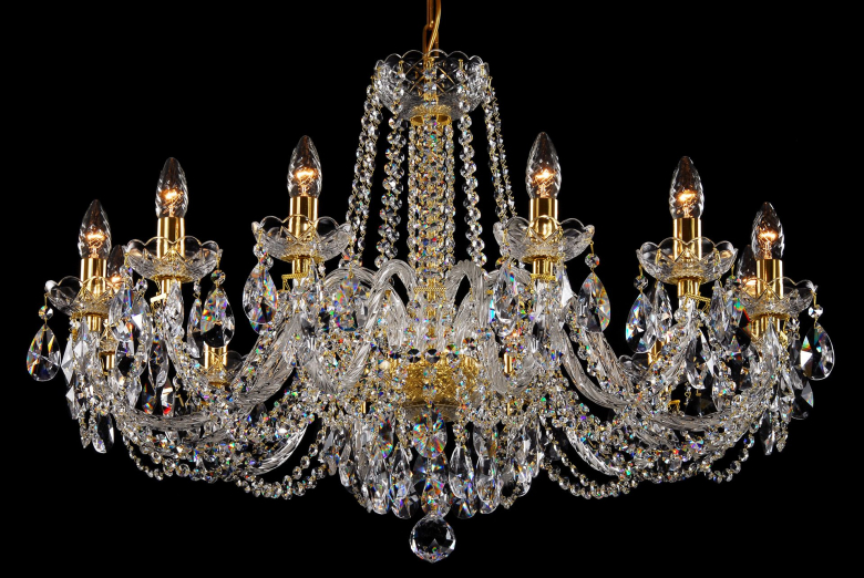 A crystal chandelier with gold coloured metal suitable for low ceilings.
