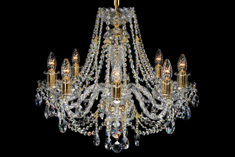An eight-arm chandelier richly decorated with crystal chains.