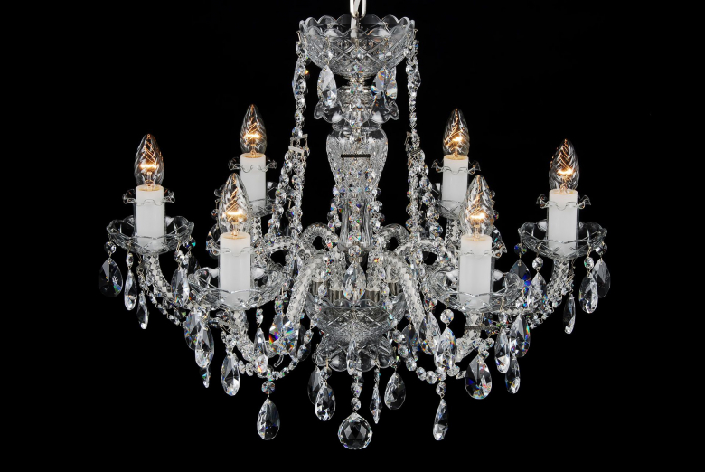 A six-arm crystal chandelier with silver coloured metal.