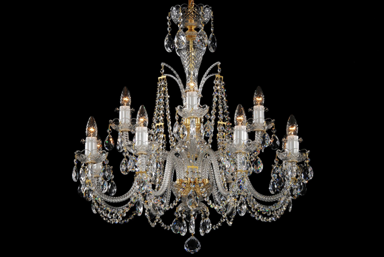 A twelve-arm clear crystal chandelier decorated with a high crown.