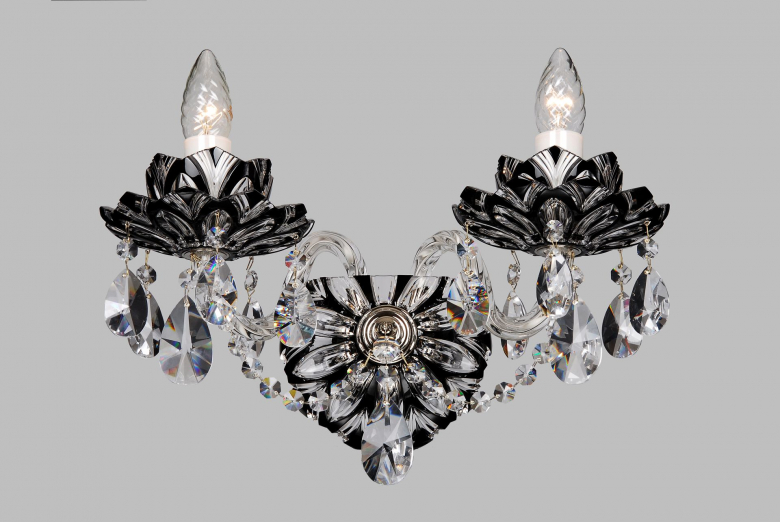A two-arm black crystal wall lamp with lotus flower design.