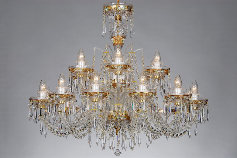 The largest golden crystal chandelier ornamented with hand painted flower motifs.