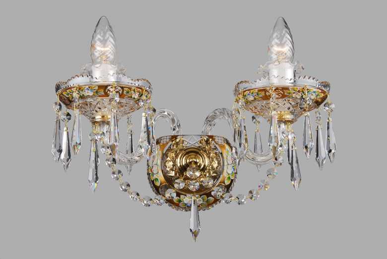 A two-arm golden crystal wall lamp decorated with a flower motif.