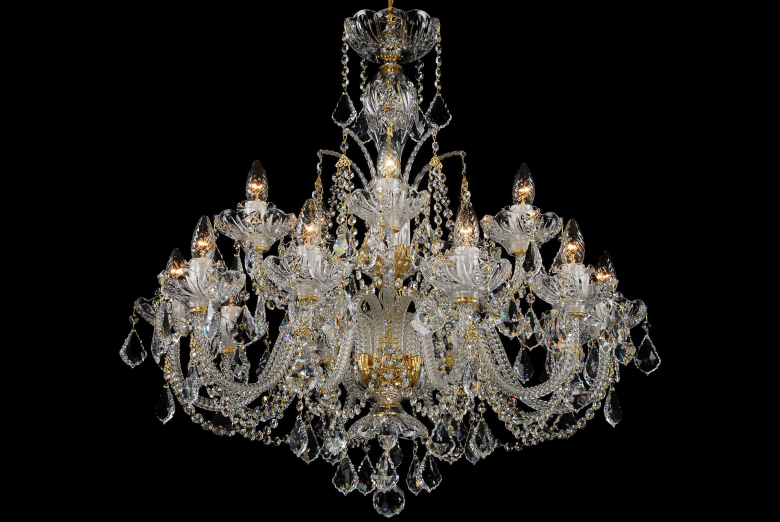 A fifteen-arm clear crystal chandelier ornamented with Swarovski trimmings.