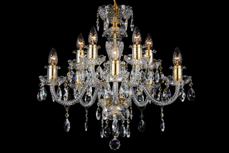 A ten-arm crystal chandelier decorated with gold coloured metal.
