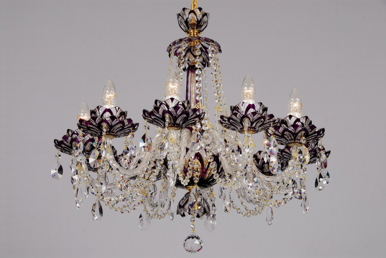 A ten-arm violet crystal chandelier with lotus flower design.