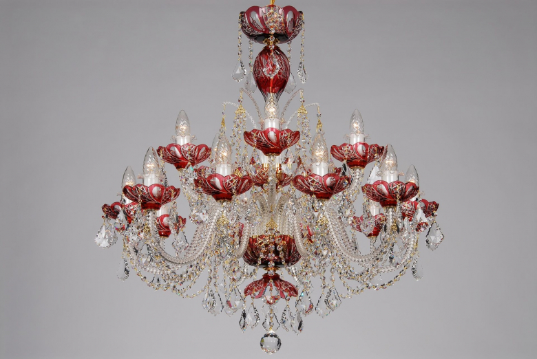 A fifteen-arm red crystal chandelier decorated with Swarovski trimmings.