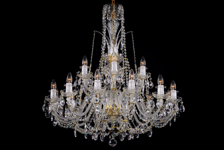 An eighteen-arm crystal chandelier complemented by a crown.