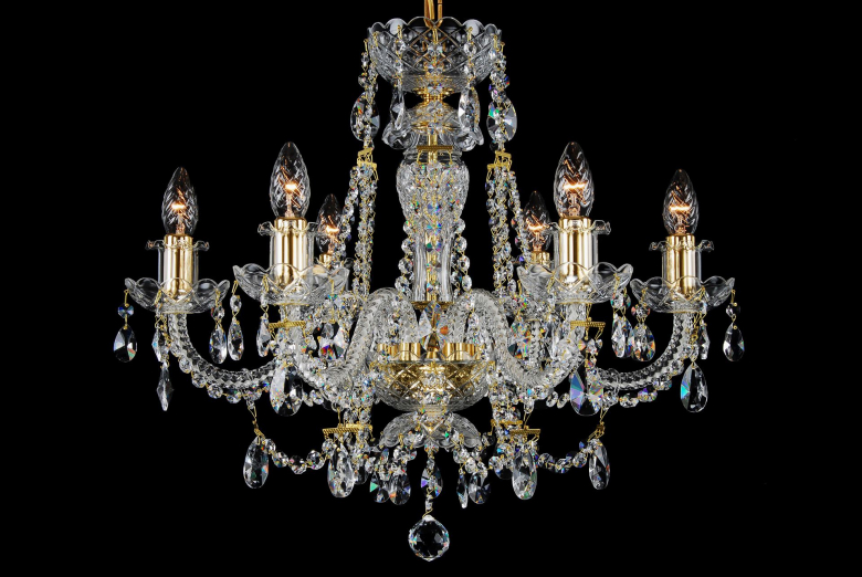 A six-light crystal chandelier decorated with golden metal.