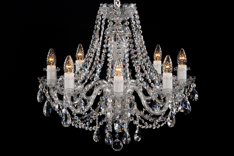 An eight-light chandelier richly decorated with crystal chains.