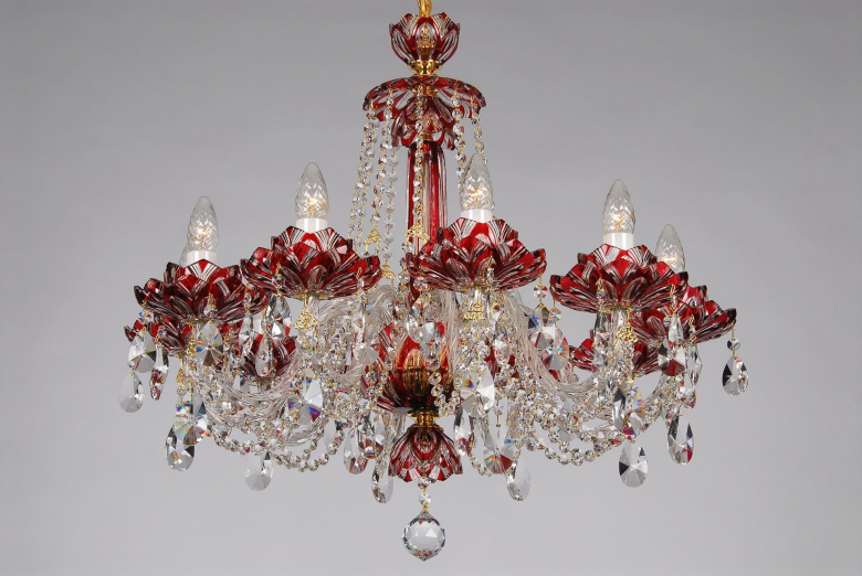 A ten-arm red crystal chandelier with lotus flower design.