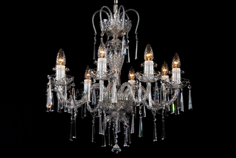 A crystal chandelier with silver coloured metal decorated with hoof-shaped trimmings.