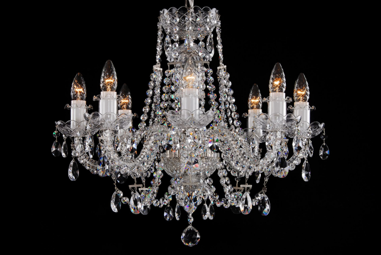 An eight-arm chandelier decorated with crystal chains.