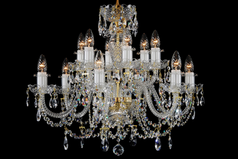 A twelve-arm colourless chandelier ornamented with crystal chains.