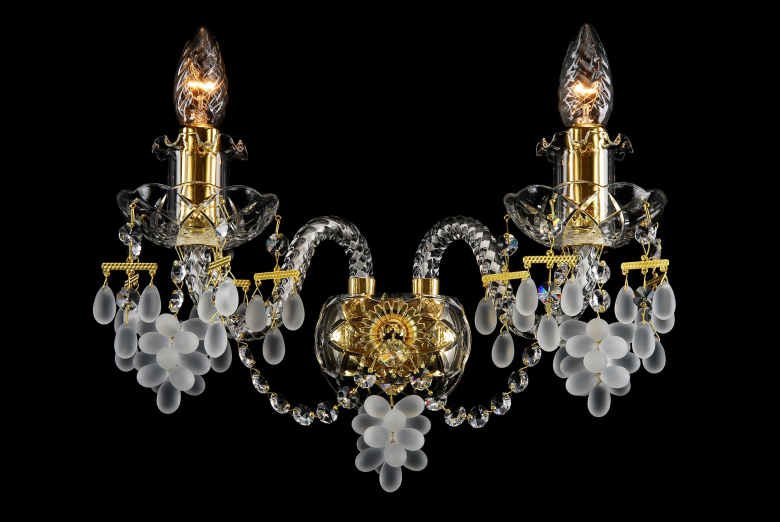 A two-arm crystal wall lamp ornamented with grape-shaped trimmings.