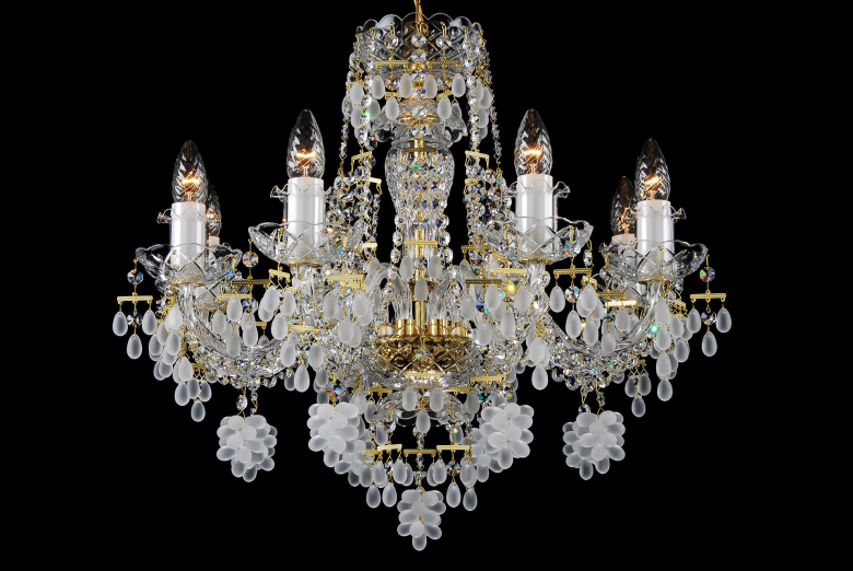 An eight-light crystal chandelier decorated with grape-shaped trimmings.