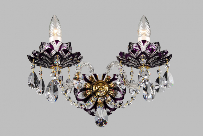 A two-arm violet crystal wall lamp with lotus flower design.