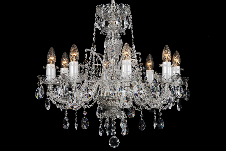 An eight-arm crystal chandelier decorated with a high crown.