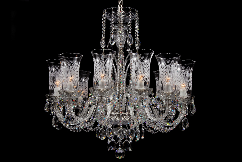Silver crystal chandelier decorated with hand cut vases.