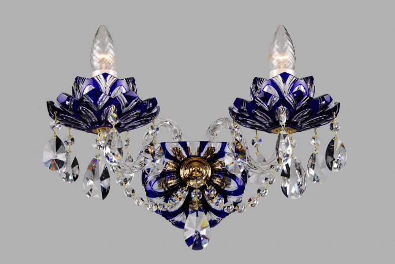 A two-arm blue crystal wall lamp with lotus flower design.
