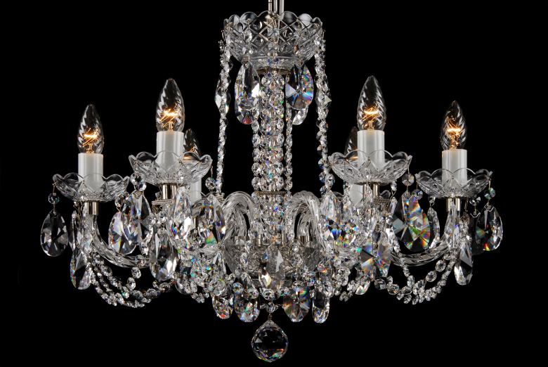 A six-arm silver crystal chandelier is suitable for interiors with low ceiling.