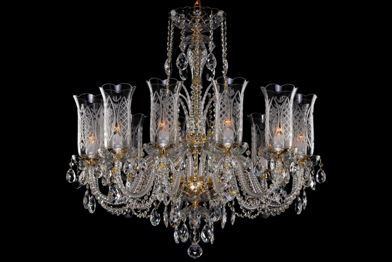 A twelve-arm crystal chandelier decorated with hand cut vases.