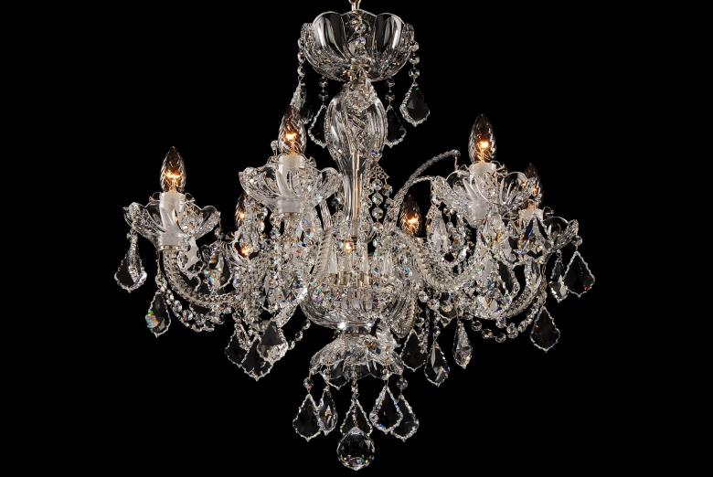 A six-arm neutral crystal chandelier decorated with Swarovski trimmings.