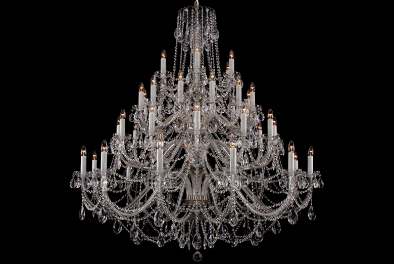 The largest clear crystal chandelier with silver coloured metal parts.