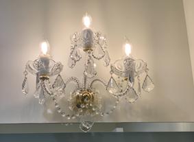 Crystal wall light hanged upon a mirror, Los Angeles, USA